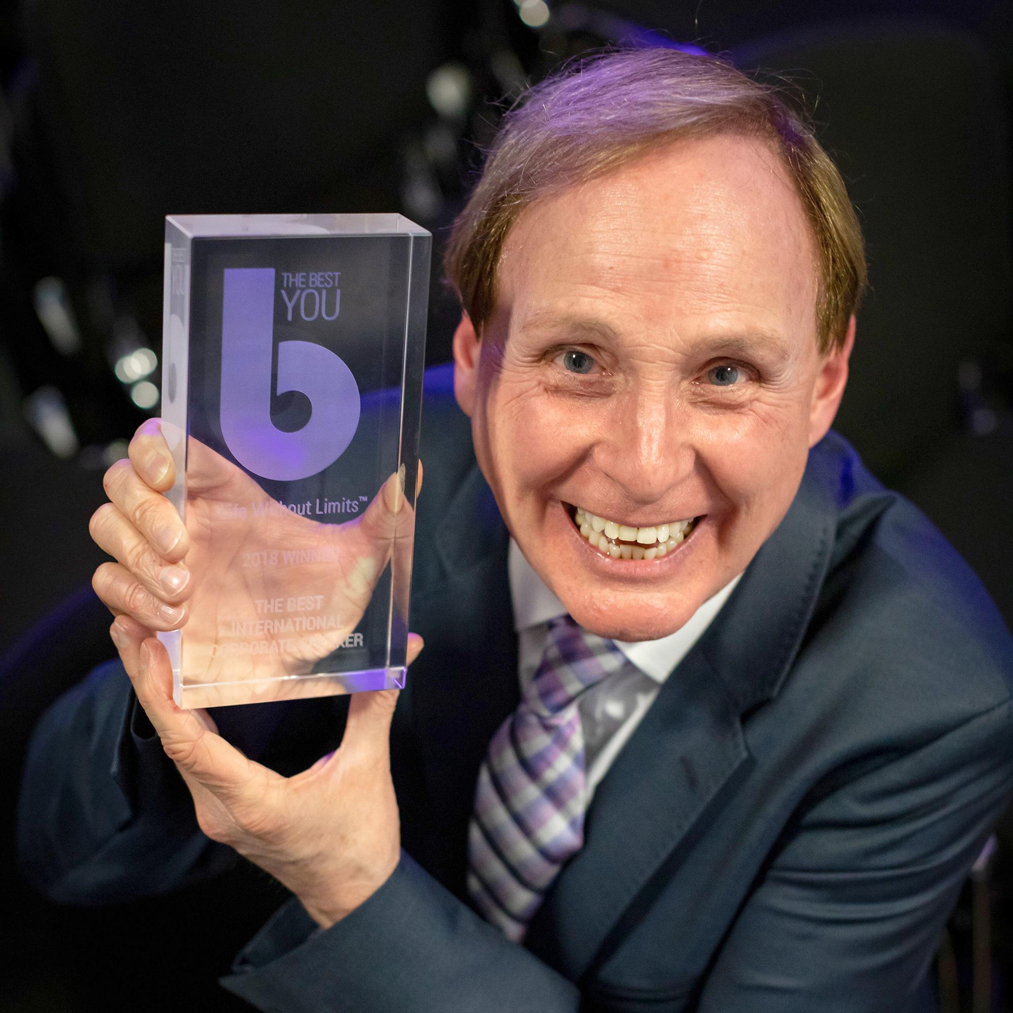 Paul Boross holding his award for Best International Corporate Speaker