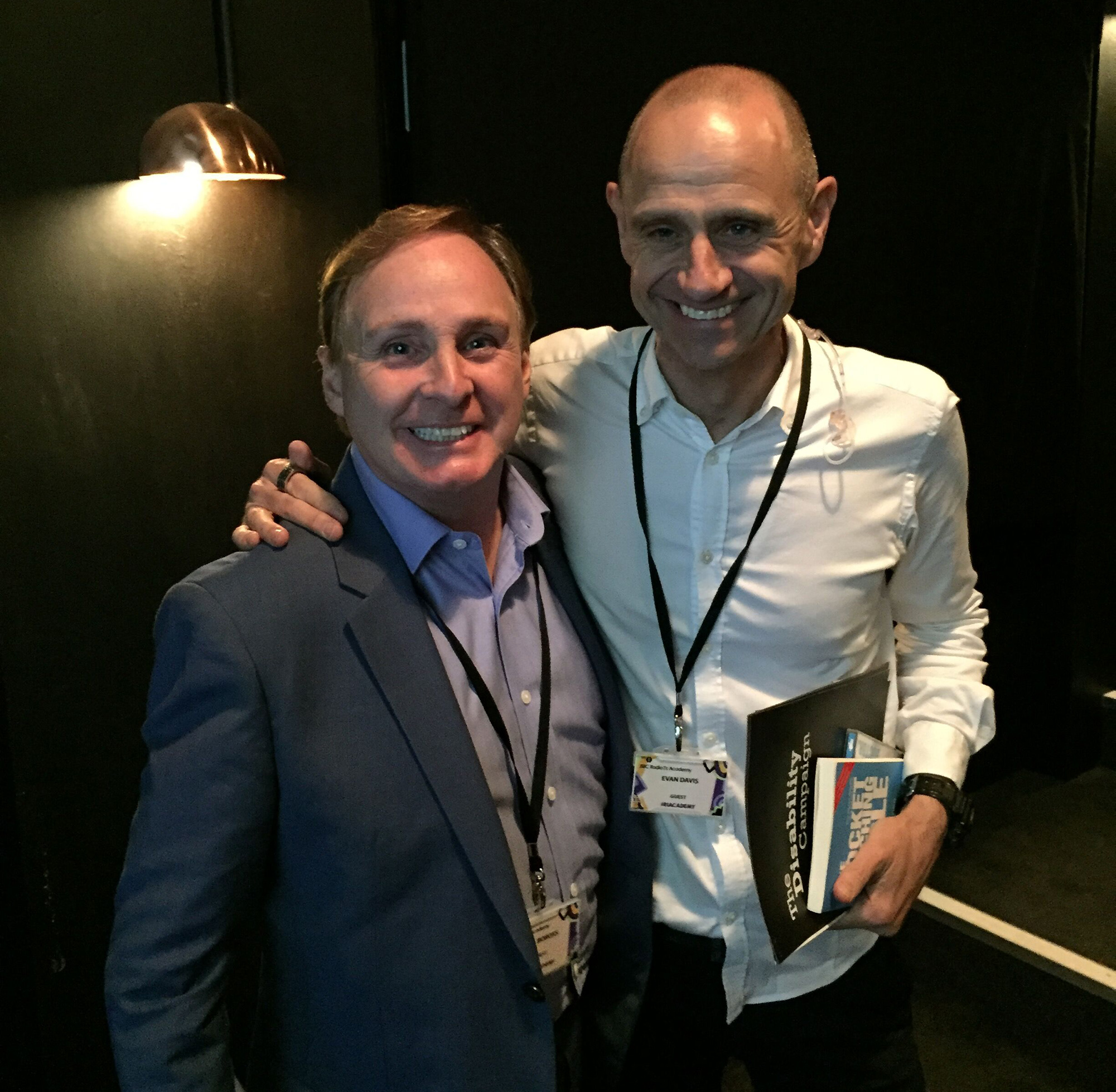 Paul Boross and BBC TV Dragon's Den presenter Evan Davis co hosting a media training day for BBC Radio 1.. Evan Davis is holding The Pocket Pitching Bible 1